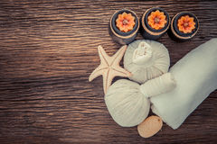 Spa Massage. Setting with rolled, towel, candlelight stock photography
