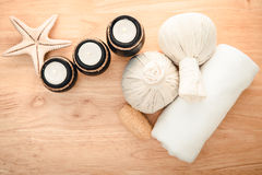 Spa Massage. Setting with rolled, towel, candlelight stock photo