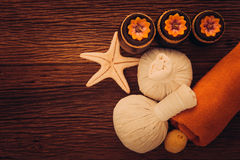 Spa Massage. Setting with rolled, towel, candlelight stock photos
