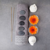 Spa massage setting with rolled towel, thai herbal compress balls and flowers. Flat lay. Top view Royalty Free Stock Images