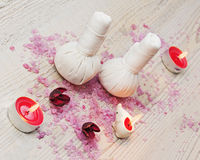 Spa massage setting with thai herbal compress stamps. Stock Photos