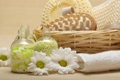 Spa - massage tools and bath salt. Spa - massage tools, flowers and bath salt royalty free stock photo