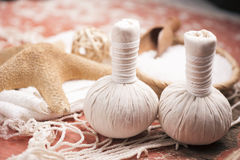 Spa massage with towel and herbal balls Royalty Free Stock Photo