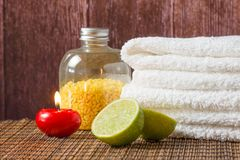 Spa massage with towel stacked red candle and lime Royalty Free Stock Photography