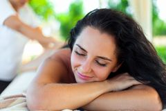 Spa Massage For Woman. Therapist Massaging Female Body With Aromatherapy Oil. Beautiful Healthy Happy Girl Relaxing Back Massage. At Beauty Salon Outdoors. Skin stock images