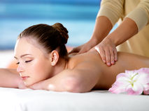 Spa massage for young beautiful woman Royalty Free Stock Photos