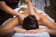 Spa. Masseur doing massage on woman body in the spa salon royalty free stock image