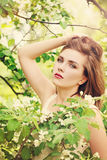 Spa Model Outdoors. Spa Woman with Healthy Skin, Red Permed Hair. Spa Model Outdoors. Spa Woman with Healthy Skin and Red Permed Hair in Spring Park Stock Photo