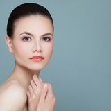 Spa Model Woman with Healthy Skin on Blue Background. Spa Beauty Royalty Free Stock Photography