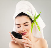 Spa Model Woman with White Bath Towel and Natural Green Leaves Royalty Free Stock Images