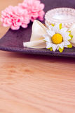 Daily spa: moisturising cream and flowers Stock Photos