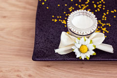 Daily spa: moisturising cream and flowers. Luxury spa beauty product, pot of moisturising cream Stock Image