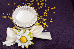 Daily spa: moisturising cream and flowers Stock Photo