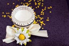 Daily spa: moisturising cream and flowers. Luxury spa beauty product, pot of moisturising cream Stock Photo