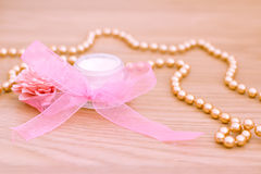 Spa moisturising lotion and gold beaded necklace. Example of luxury spa beauty products Royalty Free Stock Photos