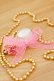 Spa moisturising lotion and gold beaded necklace. Example of luxury spa beauty products Stock Photography