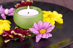 Spa motive with flowers and candle Royalty Free Stock Photo