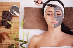 Spa Mud Mask. Woman in Spa Salon. Face Mask. Facial Clay Mask. Treatment Stock Photos