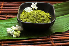Spa mud, white flower and green leaf on mat Stock Images