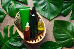 Natural cosmetic products in a basket, overhead view Royalty Free Stock Photos