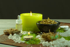 Spa nature products. Sea salt, chamomile, soap and aromatic oil. Spa accessories with soap, bowl with dried chamomile flowers, bottles with aromatic oil, sea Royalty Free Stock Image