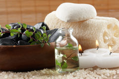 Spa objects. Bottle of massage oil and candles for a spa treatment Royalty Free Stock Photo