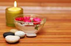 Spa objects. Stones, flowers, candle Stock Images