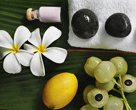 Spa objects. Tropical close-up flowers stones exotic fruits Royalty Free Stock Images