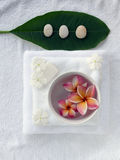 Spa objects. With tropica flowers on white towel Royalty Free Stock Images