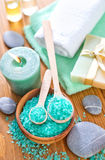 Spa objects. Sea salt and towels Stock Photo