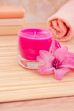 Daily spa objects, towel, soaps, candle, flower Stock Photo