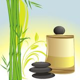 Spa oil, black stones and green bamboo Stock Images