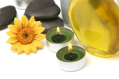 Spa oil, daisy, candles Royalty Free Stock Photos