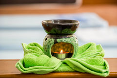 Spa oil lamps, folding cloth, spa massage room stock photography