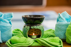 Spa oil lamps, folding cloth, spa massage room. Spa oil lamps, folding cloth, spa massage room stock photography