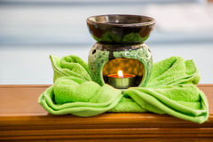 Spa oil lamps, folding cloth, spa massage room royalty free stock photos