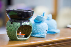Spa oil lamps, folding cloth, spa massage room.  royalty free stock image