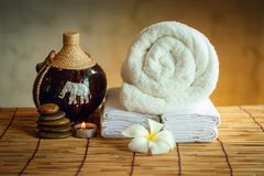 Spa Oil Massaging Treatment and Skincare Concept., Component of Therapy Massage With Plumeria or Frangipani Flowers, Towel, Stones. Aroma Candle and Oil on The royalty free stock image