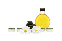 Spa oil, stones and candles Royalty Free Stock Photo