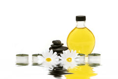 Spa oil, stones and candles Royalty Free Stock Images