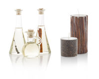 Spa oils in bottles and scented candles. With PS paths. Royalty Free Stock Photo