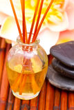 Spa oils, massage stones and lotus Stock Photos