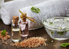 Spa oils and sea salt. On wooden table Royalty Free Stock Photo