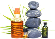 Spa oils and stones. Over white background Stock Photography