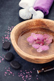 Spa with orchid flowers, zen stones and herbal massage balls Stock Image