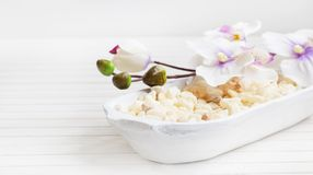 SPA orchid setting with bath salt. SPA setting with white orchid flowers and bath salt in white bowl Stock Photo