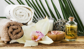 Spa orchid setting with towels, body oil, candle and salt Stock Photo