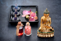 Spa with orchids, Buddha statue, sea salt, incense and bath oils Stock Image