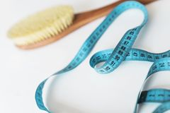 Spa organic brush for dry massage and a tape measure. Cactus brush. Anti-cellulite massage. Spa beauty concept stock photography