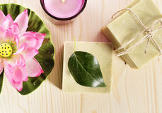 Spa organic soap, flower and candle Stock Photo